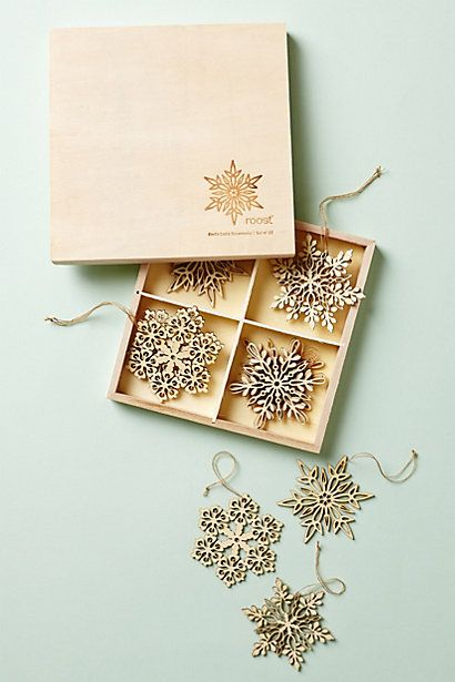 "Santa Lucia Snowflake Set #anthropologie $22  Twelve designs in a birchwood box Kiri wood 2.5"" diameter"