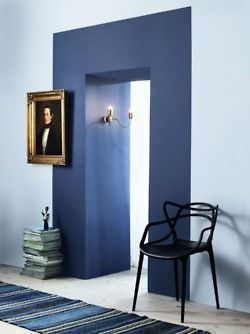 What a beautiful and different paint job! This would be a really clever way to transition colors between two rooms where there is no actual door casing or other molding.