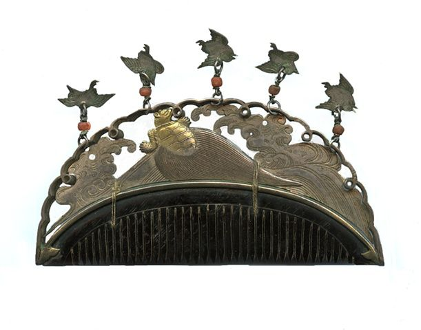 Silver hair comb from Japan done in the 1800's with Tortoise and dangling plover birds. (Miriam Slater collection)