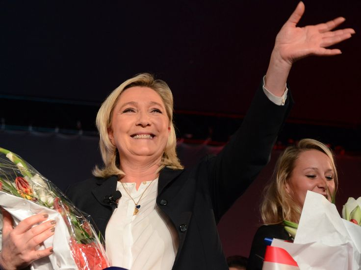 Marine Le Pen (L), French National Front political party leader and Marion Marechal-Le Pen (R), French National Front political party member and candidate in the Provence-Alpes-Cote d'Azur (PACA) region, react on stage with flowers at the end of a political rally as the campaign continues for the upcoming regional elections in Nice, France, November 27, 2015.