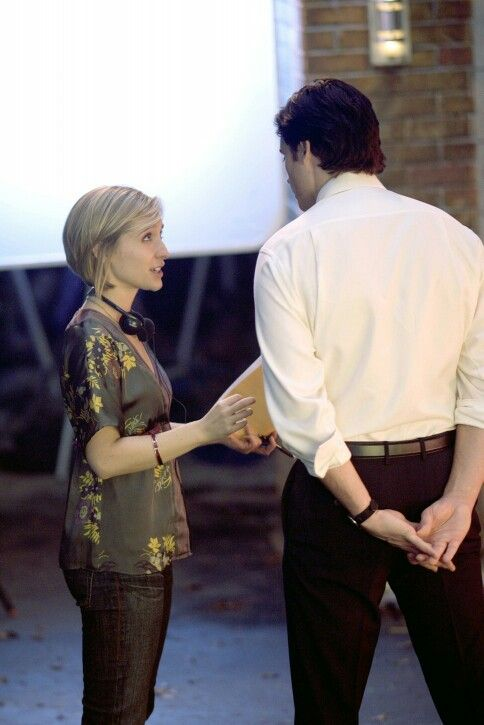 Tom taking some direction from Allison Mack