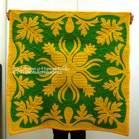 Very different gold on green color scheme in this Hawaiian wall quilt!