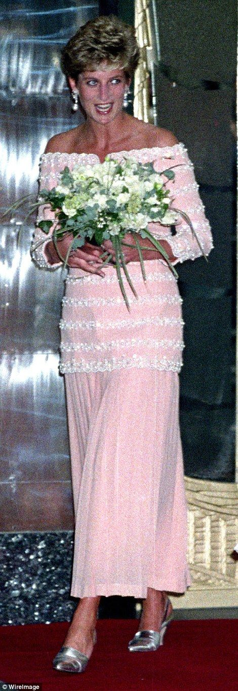The Princess wore the off-the-shoulder salmon pink evening dress with a long tunic-style bodice, pictured right, to the reopening of the Savoy Theatre in 1993, left. The gown features intricate beading and jewels