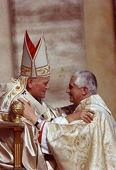 Pope St. John Paul II and Pope Benedict XVI.