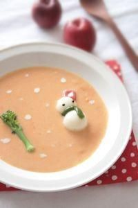 broccoli tree and bun/dumpling snowman in soup with cream dots of snow