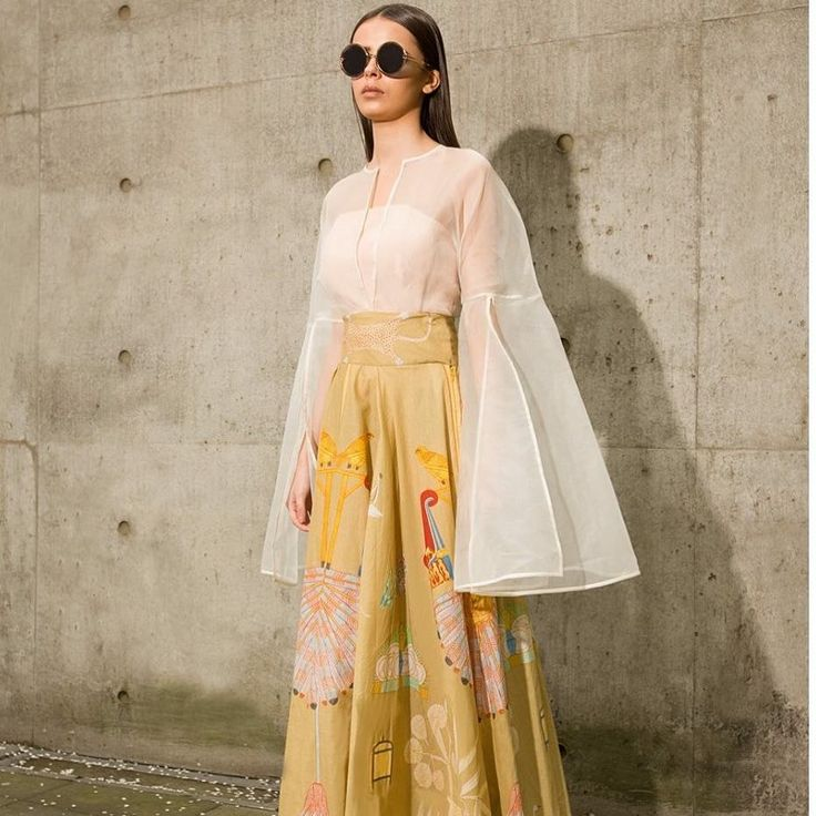 "Fahad Hussayn on Instagram: ""Draped printed lawn skirt paired with a nude corset and organza cape top Shop now at http://www.fahadhussayn.com/bazigar #limitededition…"""