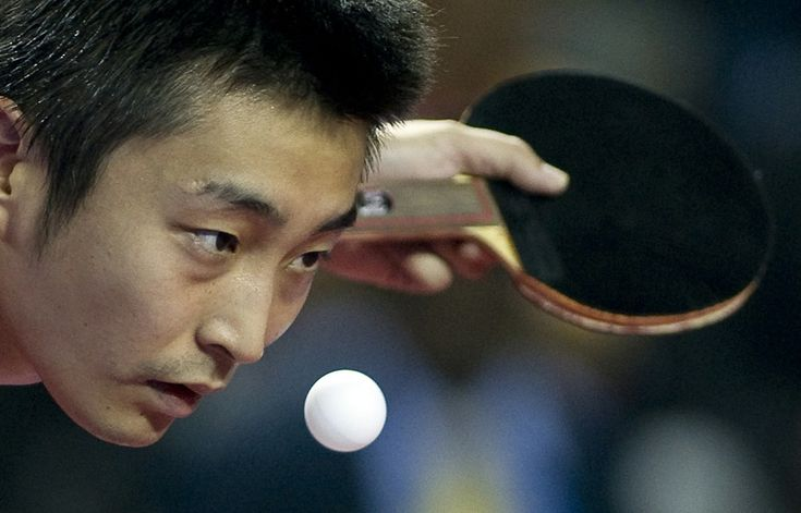 Singapore's Yang Zi plays against England's Paul Drinkhall during the table tennis men's team gold medal match at the Yamuna Sports Complex in New Delhi on October 9, 2010. (PEDRO UGARTE/AFP/Getty Images)