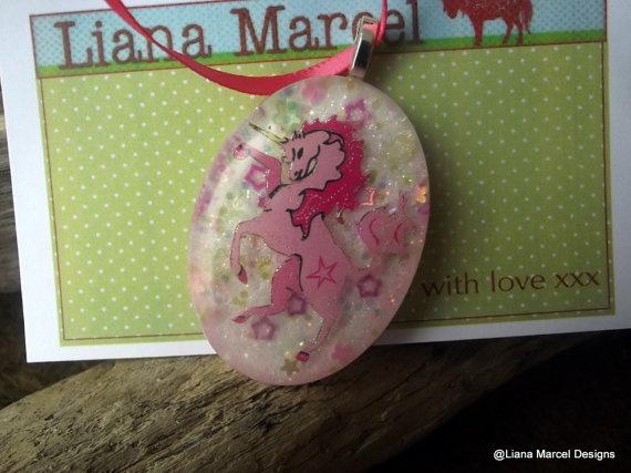 handmade pink resin unicorn pendant on satin ribbon by LianaMarcel, $15.00