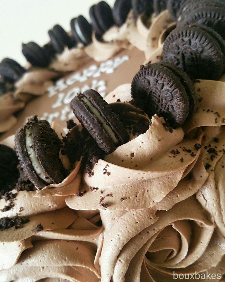 Close up of chocolate fudge oreo topped rose swirl cake