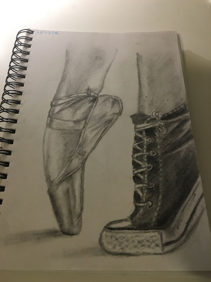 Charcoal drawing of pointe shoes and converse.