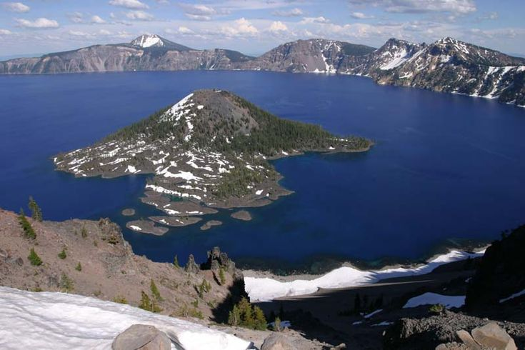Crater Lake formed by the catastrophic eruption of Mt. Mazama, a medium-sized stratovolcano of the Oregon Cascades, about 6850 years ago. During this eruption, so much material was emptied from the underlying magma chamber that much of the volcano collapse downward, forming the caldera, which later filled in with water. Wizard Island formed as a series of andesitic eruptions soon after the caldera collapse. Crater Lake is now the deepest lake in the United States, with at depth of 1949 feet.