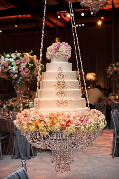 For a spectacular look, a wedding cake was suspended from the ceiling by crystal chains creating a striking chandelier ~ http://homemadehooplah.com/recipes/no-bake-pink-lemonade-cheesecake-parfaits/