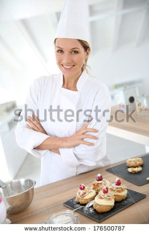 Successful woman confectioner in professional kitchen - stock photo