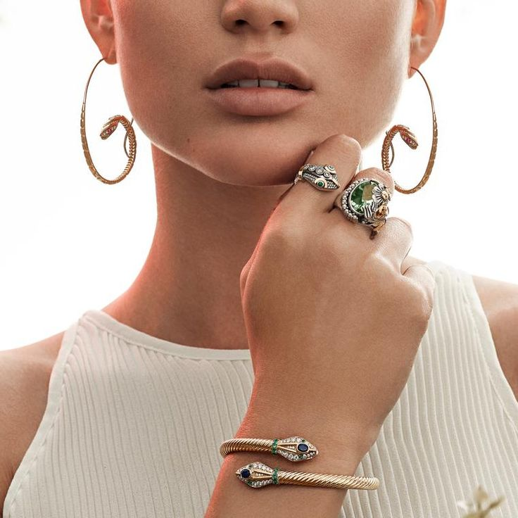 Azza Fahmy gold snake jewellery : hoop earrings, ring and bracelet with green and blue gemstone details. http://www.thejewelleryeditor.com/jewellery/article/azza-fahmy-wonders-of-nature-jewellery-collection/ #jewelry