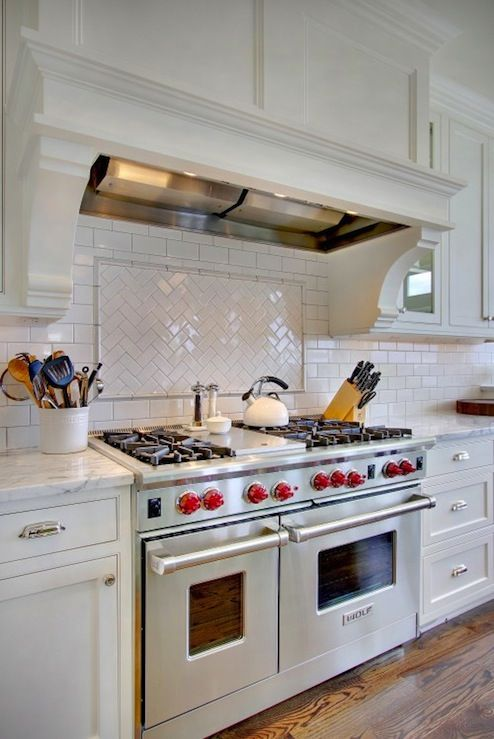 "Love the kitchen backsplash with the Wolf 48"" All Gas Range under the Ventahood Insert ventilation rangehood."