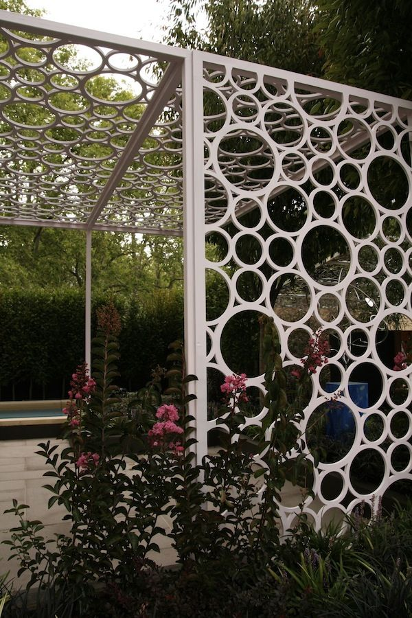 Design Ian Barker. Make with PVC pipe rings would make a great trellis or just a mod gazebo type seating area!
