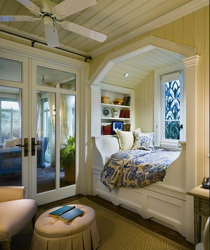 book nook :) I just want to curl right up in it! Love the beadboard walls and ceiling and the special stained glass window! This nook is big enough to sleep a guest on too. Love that!