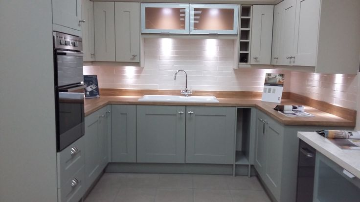 BY DESIGN Rye Painted To Order Kitchen in two colours, Ceramic Sink Drainer and Laminate Wood Effect Worktops with Upstands on display in our Weymouth Showroom