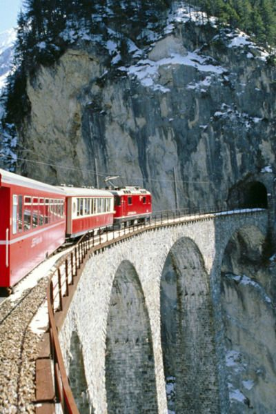 Switzerland, the red train. Imagine that view-sipping a hot mug of swiss hot chocolate.