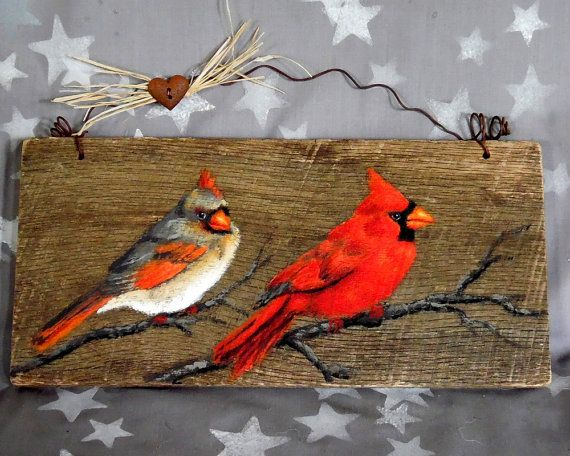 A pair of cardinals sit on a bare branch, but they are looking for berries, so they will move on to a more plentiful branch. These cheerful birds are painted on a rustic barn board reclaimed from an old Ozarks barn, falling down from old age and weathering. The board is hung with a wire hanger made of rusty corral wire, and adorned with a faux rusty tin heart, and a bit of raffia.  Click on the Shipping & Policies tab to view the shipping rates for this item. All items DO ship…