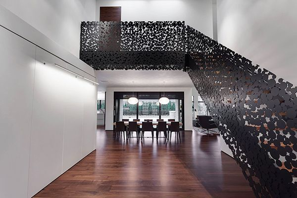 Stylish Mansion in Canada Adorned With a Surprising Black-Dotted Staircase