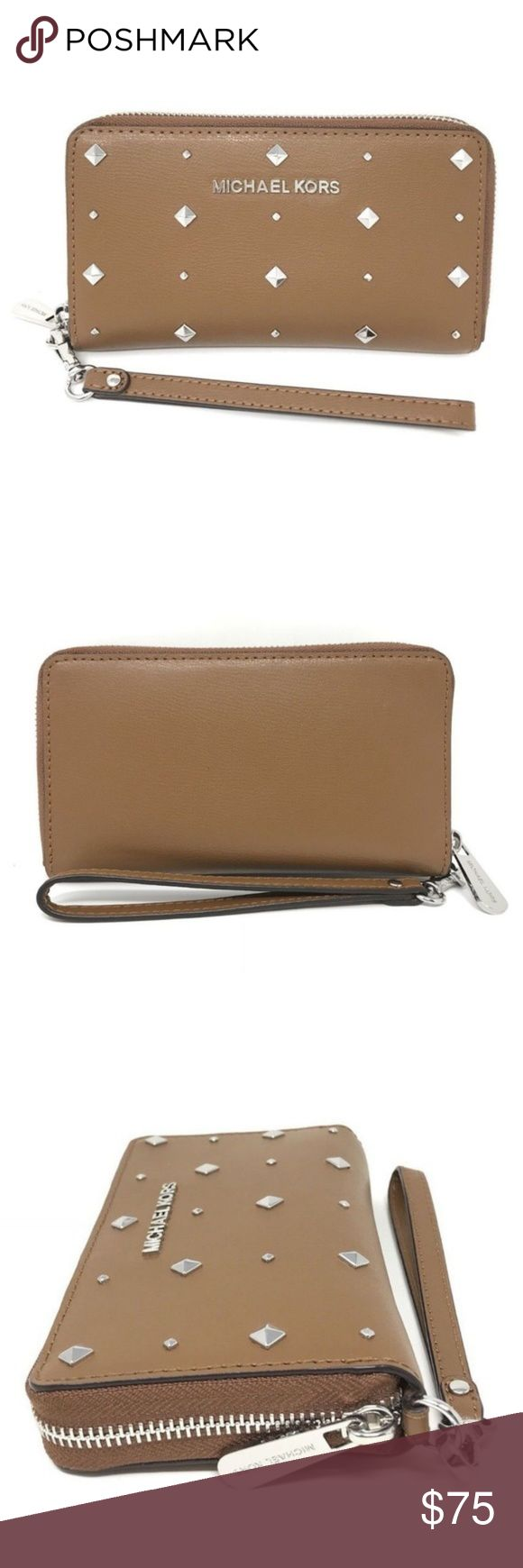 Michael Kors Leather Stud Het Set Travel Wallet Michael Kors Leather Stud Het Set Travel Flat MF Luggage Phone Case Wallet  item# 273094457078  100% Authentic Michael Kors!  Buy with confidence!  MSRP: $168.00  Style: 35H7STVE3T  Features:  Brand: Michael Kors  Color: Luggage  Zip around wallet w/ wristlet  Soft Leather w/ Studs accent on front  Michael Kors Lettering Logo on front  Zippered closure  Silver tone hardware  Cell phone pocket  1 zippered/coin pocket  1 slip pocket, 7 card…