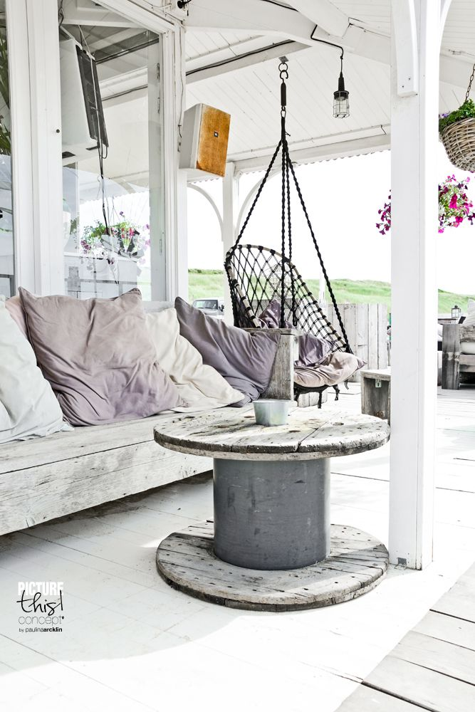I like the over sized lavender pillows on the wood bench. Would be pretty with brown tones of cabin. © Paulina Arcklin