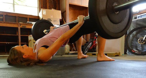 Looking to flatten your abs and/or beef up your backside? Do the Weighted Glute Bridge — it's a powerful, underutilized move that isolates the glutes and helps carve out a flat, compressed core.