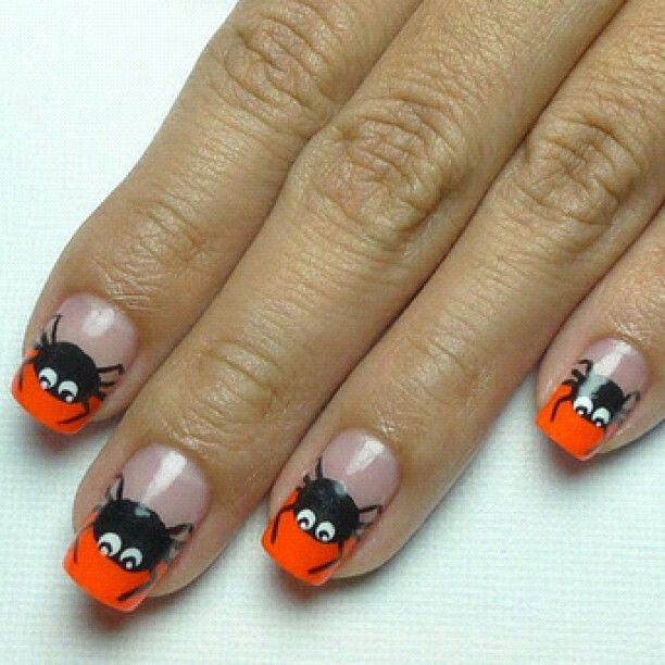 cool orange nail tips with cutesy black spiders