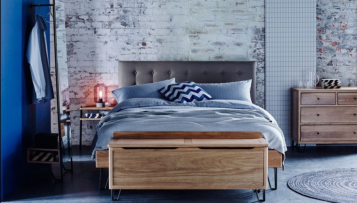 Rob Scarlett's hugely popular Brunel range sets industrial style against mid-century Scandinavian design to create pieces made for modern living. The Brunel Bed features a solid oak frame and headboard that is tailored in a choice of wheat beige or smokey grey fabric each complete with button cushion detail.