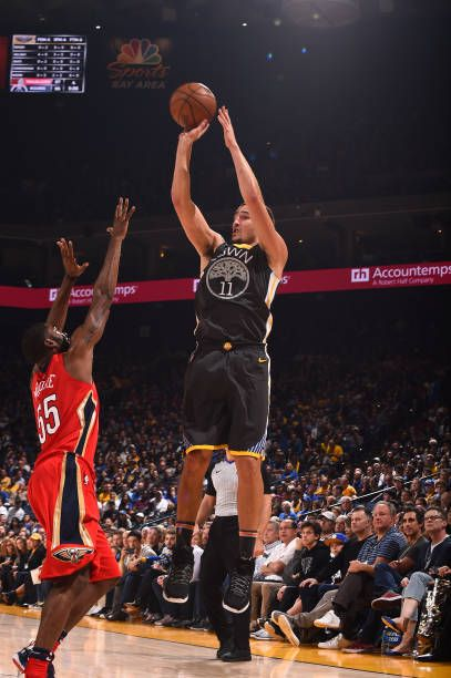 Klay Thompson of the Golden State Warriors shoots the ball against the New Orleans Pelicans on November 25 2017 at ORACLE Arena in Oakland California...