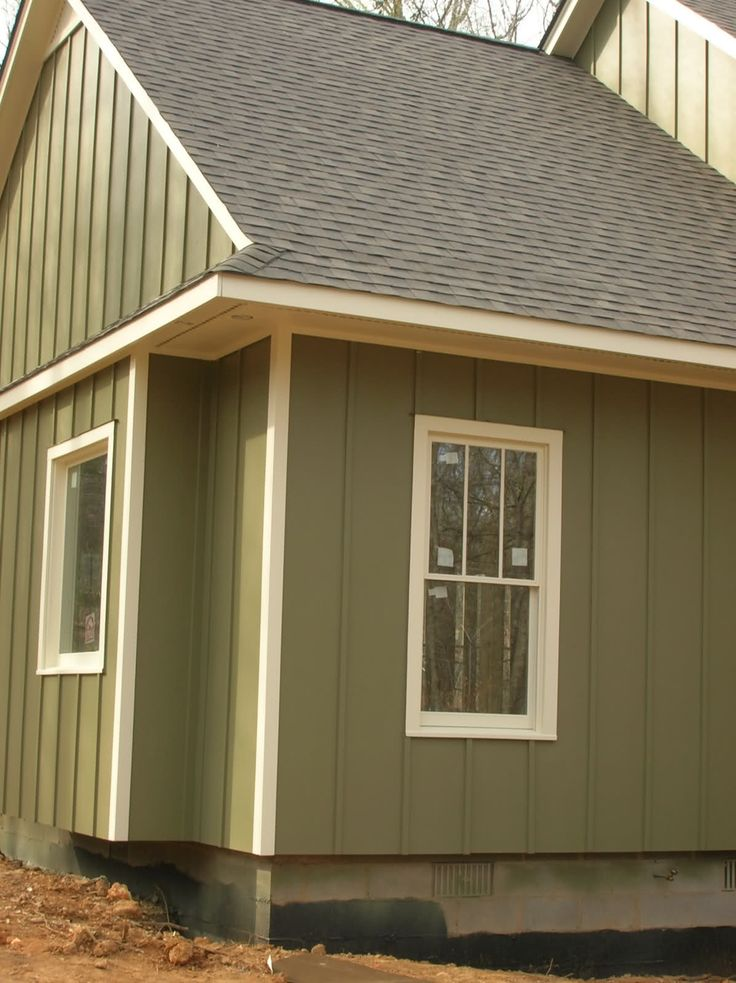 Board and batten siding green board batten siding with for Homes with wood siding