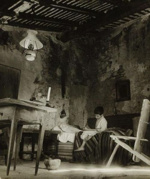 by Willy Ronis Vincent in a peasant interior at Gordes, France 1948.