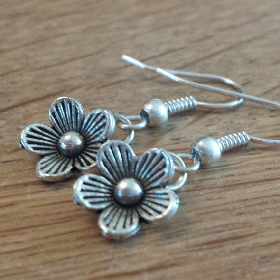 Check out this item in my Etsy shop https://www.etsy.com/uk/listing/252173033/beautiful-flower-earrings-tibetan-silver
