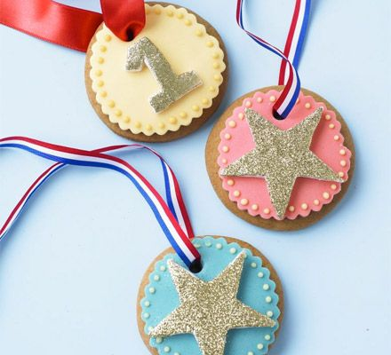 Make these round vanilla biscuits, ice in bright colours, thread on a ribbon and give out as edible prizes