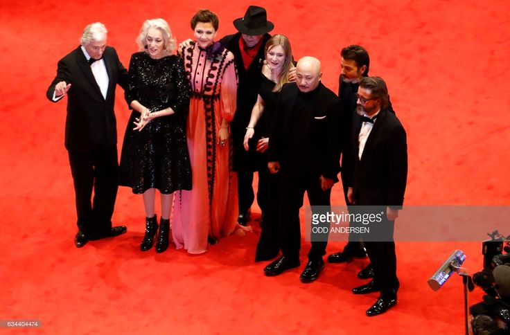 President of the jury, Dutch director Paul Verhoeven and other jury memebrs Tunisian producer Dora Bouchoucha Fourati, US actress Maggie Gyllenhaal, Berlinale Director Dieter Kosslick, German actress Julia Jentsch, Chinese director Wang Quanan, Mexican director Diego Luna, Icelandic artist Olafur Eliasson arrive for the opening of the Berlinale film festival with the premiere of 'Django' during the 67th Berlinale film festival in Berlin on February 9, 2017. / AFP / Odd ANDERSEN