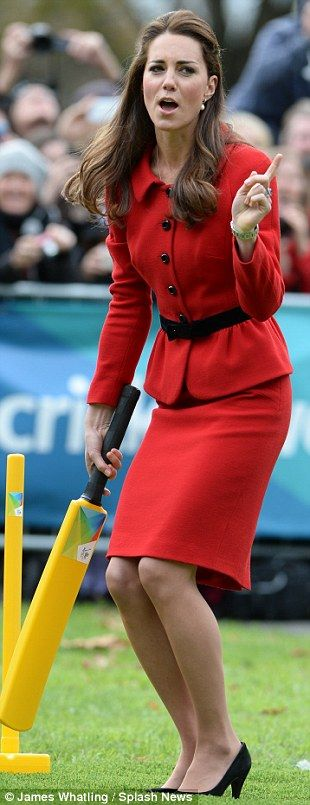 Refreshing: While she may have been wearing a pristine suit and heels, Kate wasn't afraid to show her fun-loving silly side #katemiddleton