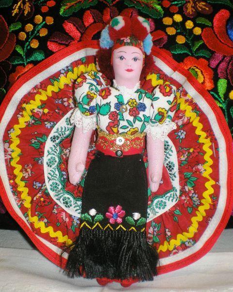 A porcelain china doll from Mezőkövesd, in Matyó style.