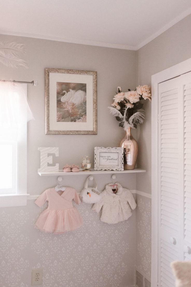 How sweet is this little decorative corner of her Swan Lake nursery? A perfect way to fill the space behind the closet doors.