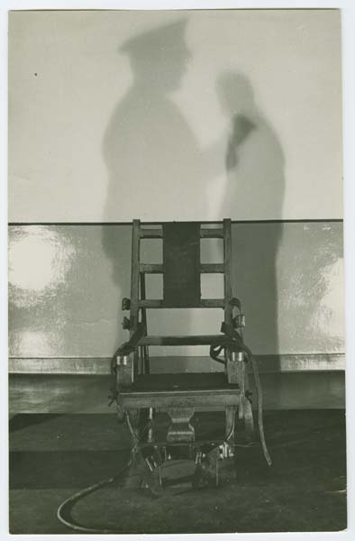 Photograph showing electric chair with shadows of a guard and prisoner, date unknown.     Source: Lewis Lawes Collection. Special Collections, Lloyd Sealy Library, John Jay College of Criminal Justice  www.lib.jjay.cuny.edu/crimeinny