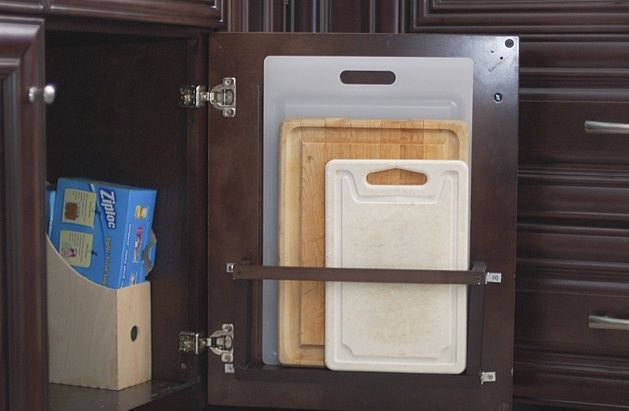 Slim boards stay tucked away (but won't stop your cabinet from closing) in this clever storage spot. Get the tutorial at Tikkido »