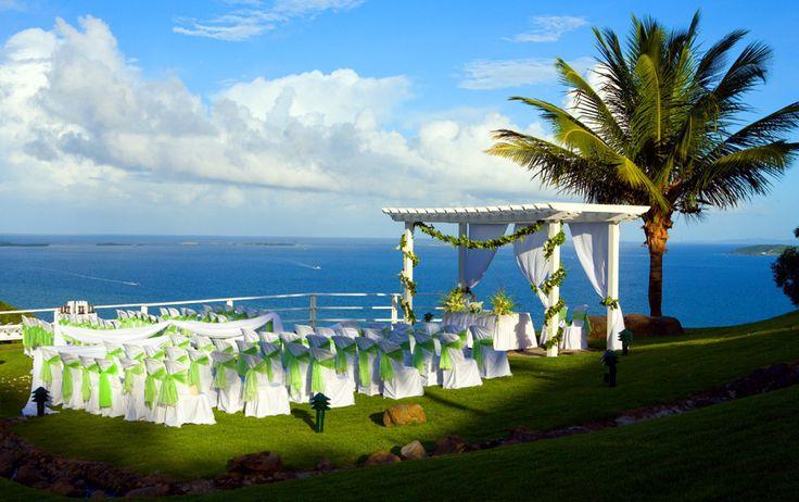 Wedding ceremony at Casitas Garden at El Conquistador Resort in Puerto Rico. © Noel Del Pilar