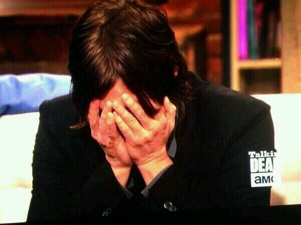 Embarrassed  3/2/14 - Norman Reedus embarrased by Talking Dead's host, Chris Hardwick, playing around with a life sized Daryl Dixon cut out.