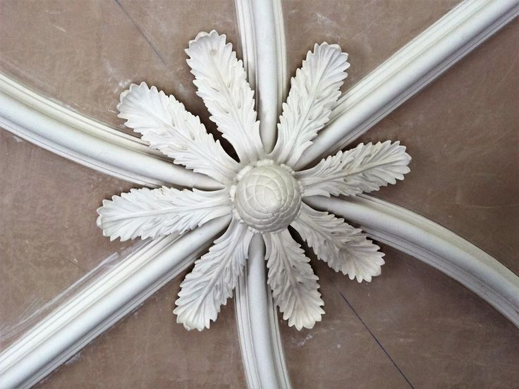 Bespoke fibrous plaster detail within a ribbed ceiling design. Sculpted and cast by hand.