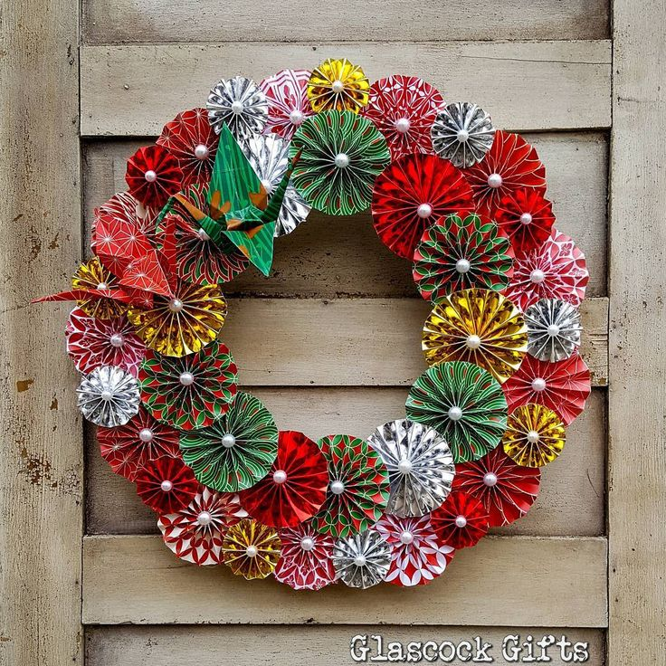 """14"""" folded pinwheel rosette wreath with paper cranes in the custom order for a Japanese restaurant. Done in red and green Japanese themed paper with reflective metallic accents. #glascockgifts #origami #paper #paperart #paperwreath #wreath #papercranes #japan #handmade #christmaswreath #christmas"""