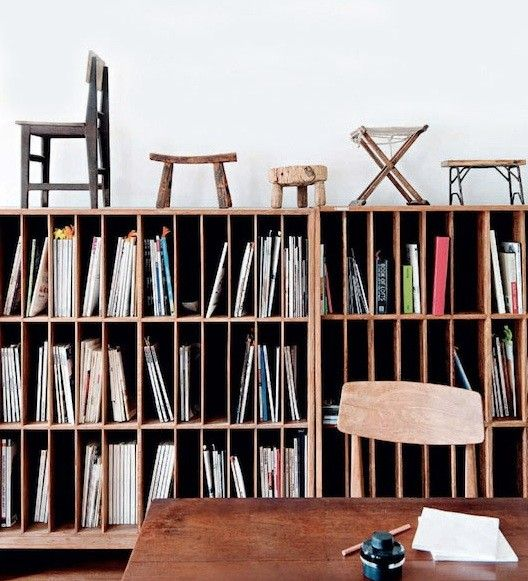 Wood Magazine Library with Antique Wood Stools in Beijing, Remodelista