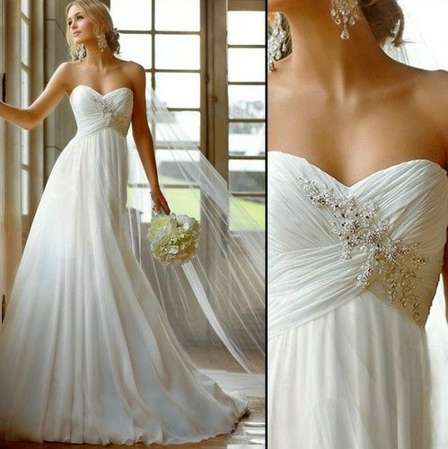 For the bride who desires a more simple-yet-elegant, Greek-Style wedding gown. Features a empire diagonal sash waist, a pleat-like flowing skirt, and a sweep train. Perfect for the more casual setting.
