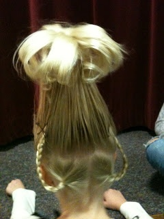 Cindy Lou Who hair- pony tail created over top of a solo cup on top of the head, braids pinned up.