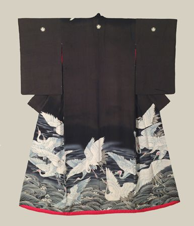 "Yuzen Uchikake - Mid to late Meiji (1880-1911). A very fine silk antique uchikake featuring yuzen-dyed cranes in flight. Embroidery highlights. Five mon (family crests).  49"" from sleeve-end to sleeve-end x 62"" height. The crane is one of the three major mystical animals, together with the dragon and the tortoise. Its chief symbolic meaning is long life.  The Kimono Gallery"