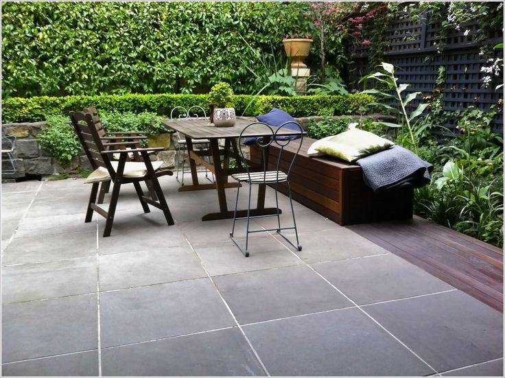 Patio-Traditional-Melbourne-bench-seat-courtyard-cushions-garden-hedge-lattice-fence-Metal-cafe-chairs-outdoor-dining-small-garden-stone-wall-storage-box-tile-floor-Timber-furniture-wood-deck-wood-table-and-chairs-id-1716.jpg 996×746 pixels